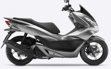 Honda PCX 125cc or similar